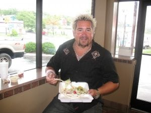 guy fieri with pizza palace food
