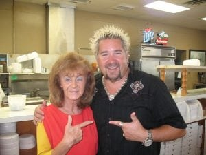 guy fieri with pizza palace employee