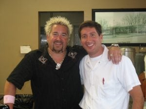 guy fieri with pizza palace owner