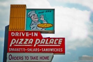 pizza palace roadside sign